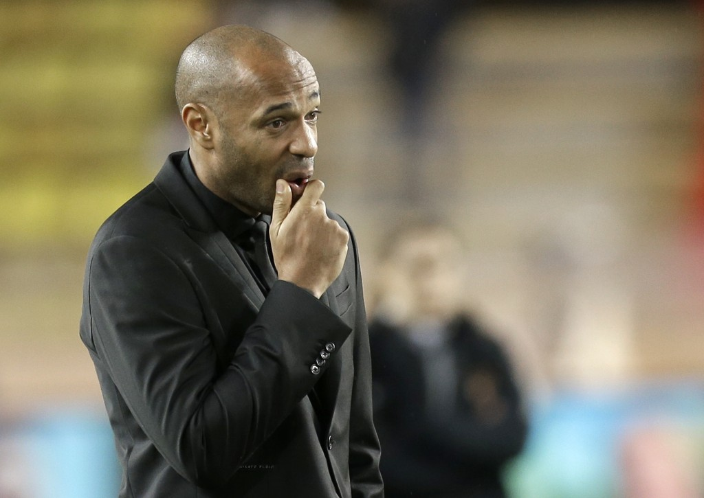 Monaco coach Thierry Henry watches the players as they train before the Champions League Group A soccer match between Monaco and Club Brugge at the Lo