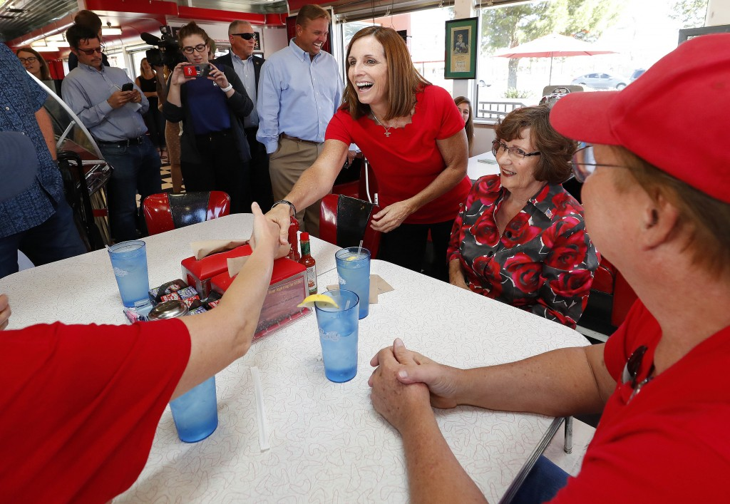 Arizona Republican senatorial candidate Martha McSally, speaks with voters, Tuesday, Nov. 6, 2018, at Chase's diner in Chandler, Ariz. McSally and Dem...