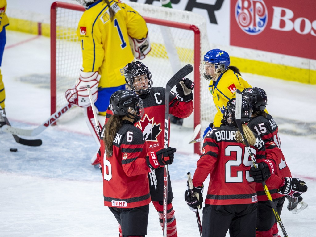 Canada celebrates a goal against Sweden during the third period of a Four Nations Cup preliminary hockey game in Saskatoon, Saskatchewan, Tuesday, Nov