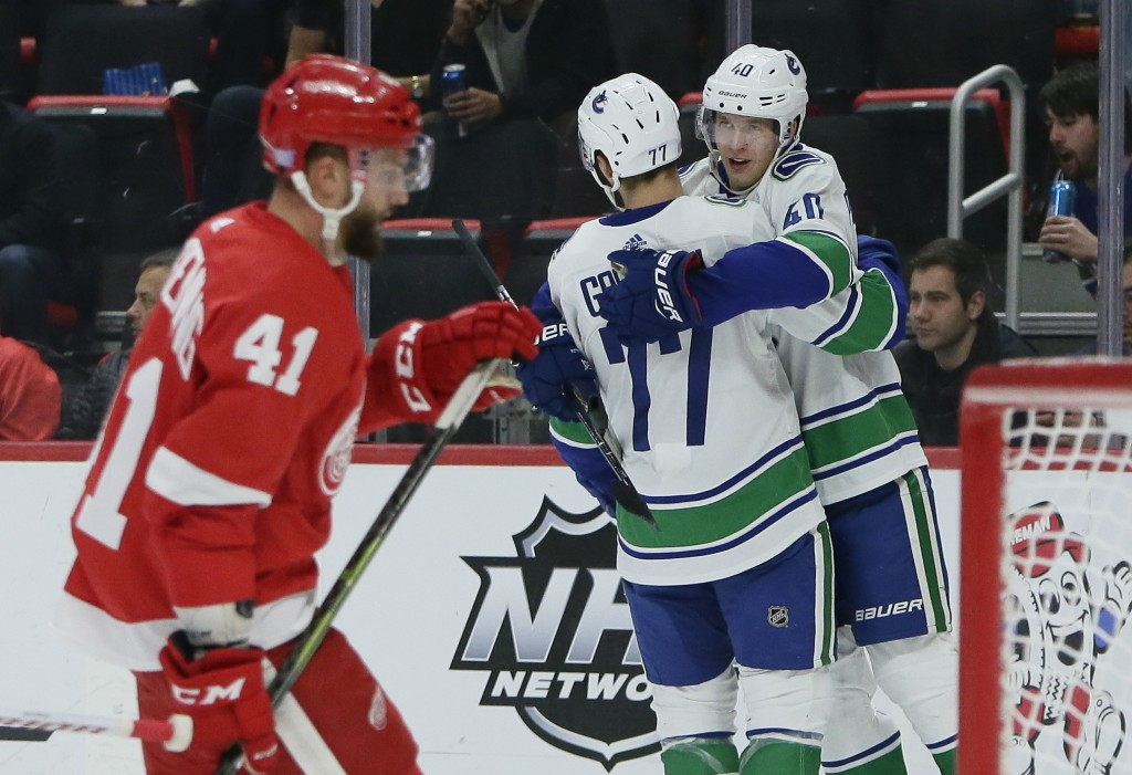 Vancouver Canucks center Elias Pettersson (40), of Sweden, celebrates his first period goal with right wing Nikolay Goldobin (77), of Russia, as Detro