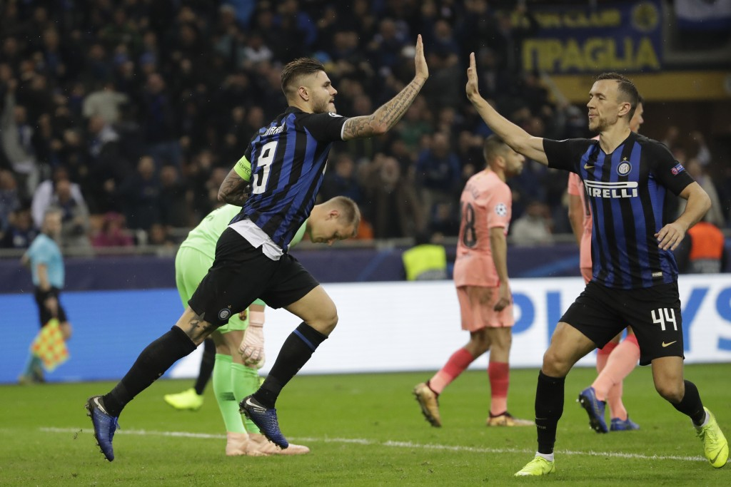 Inter forward Mauro Icardi, left, celebrates after scoring his side's opening goal with his teammate Inter midfielder Ivan Perisic during the Champion