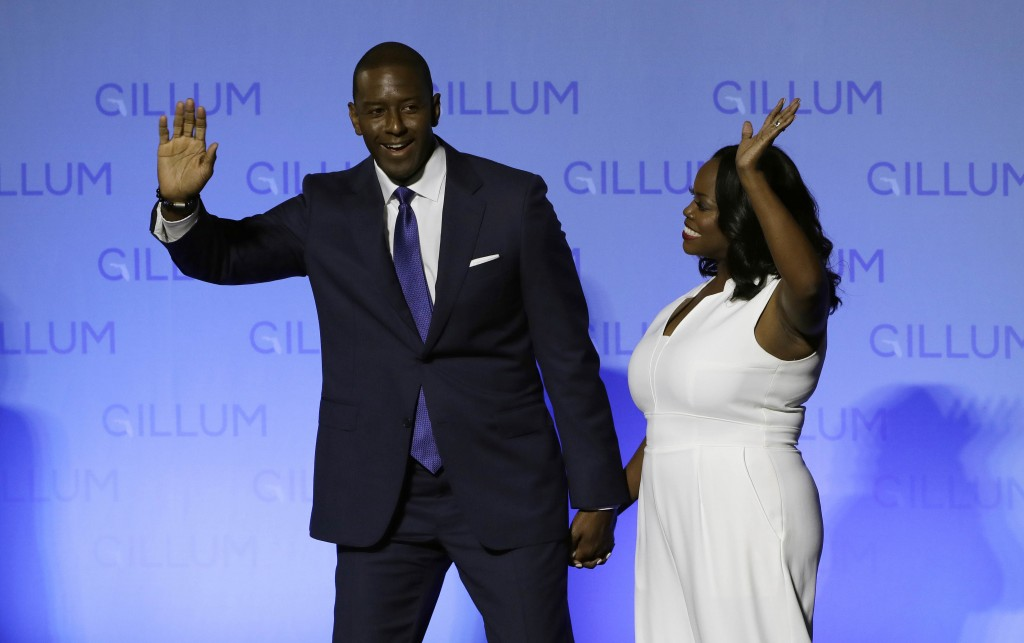 Florida Democratic gubernatorial candidate Andrew Gillum and his wife R. Jai Gillum wave to supporters before delivering his conesssion speech Tuesday...
