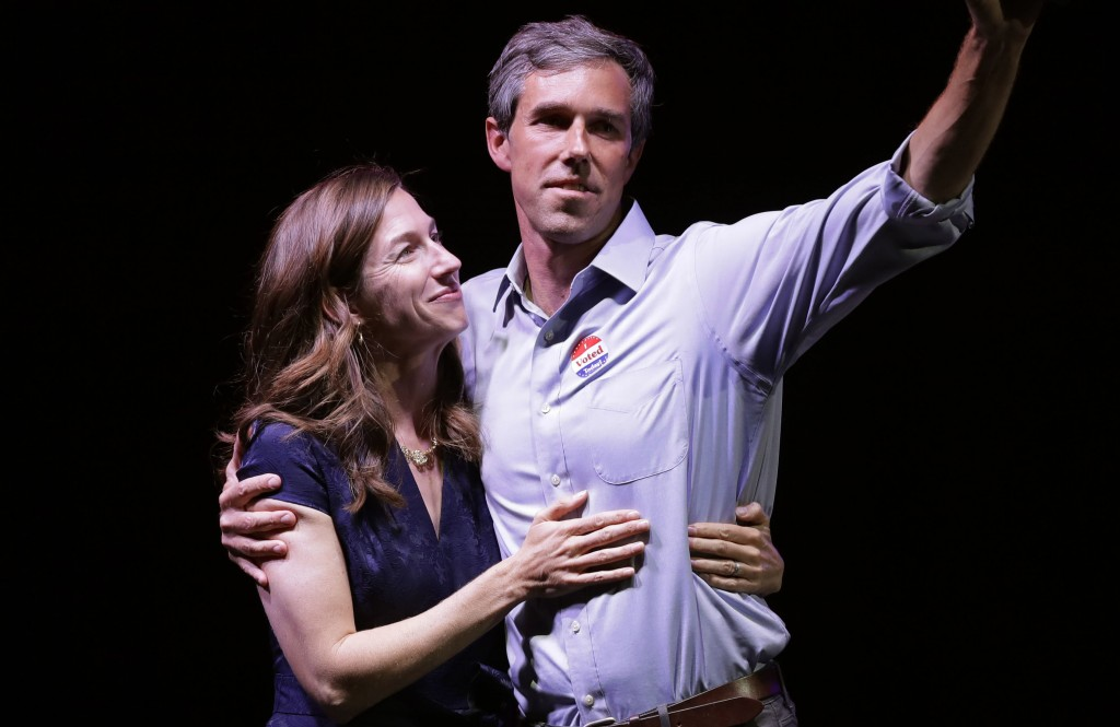 Rep. Beto O'Rourke, D-Texas, the 2018 Democratic candidate for U.S. Senate in Texas, right, stands with his wife, Amy Sanders, at his election night p...