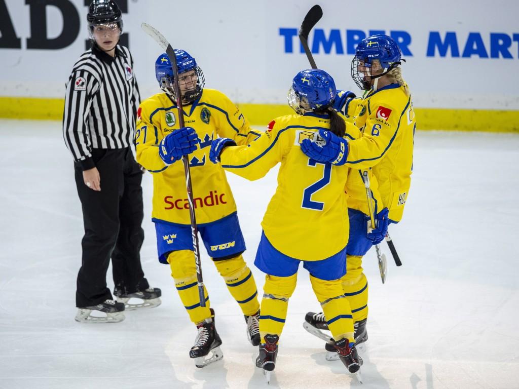 Sweden forward Emma Nordin, defenseman Emmy Alasalmi and defenseman Josefine Holmgren celebrate a power-play goal against Canada during the third peri