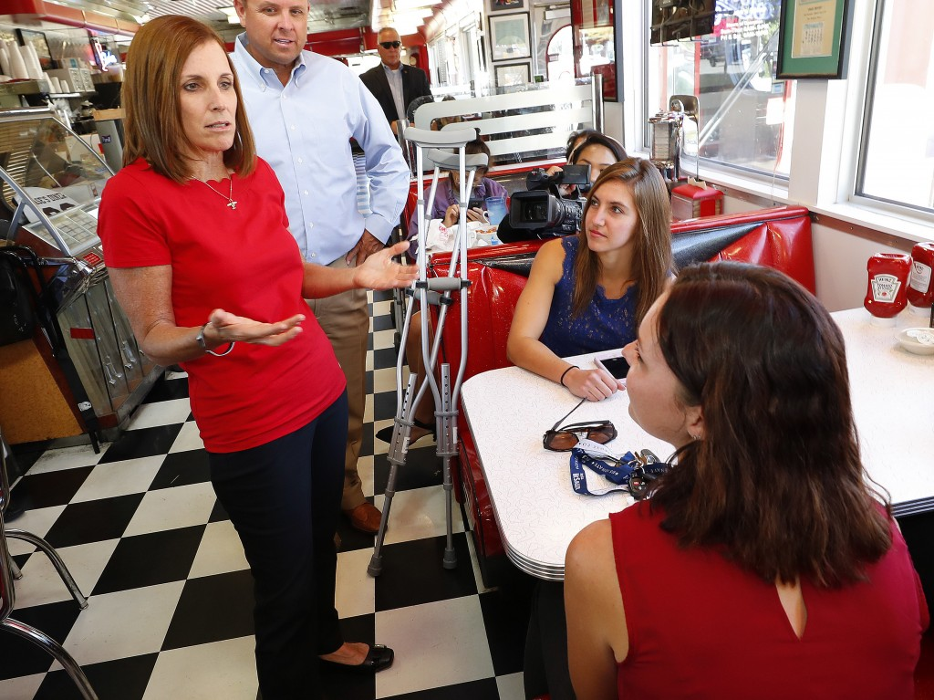 Arizona Republican senatorial candidate Martha McSally, speaks with voters, Tuesday, Nov. 6, 2018, at Chase's diner in Chandler, Ariz. McSally and Dem