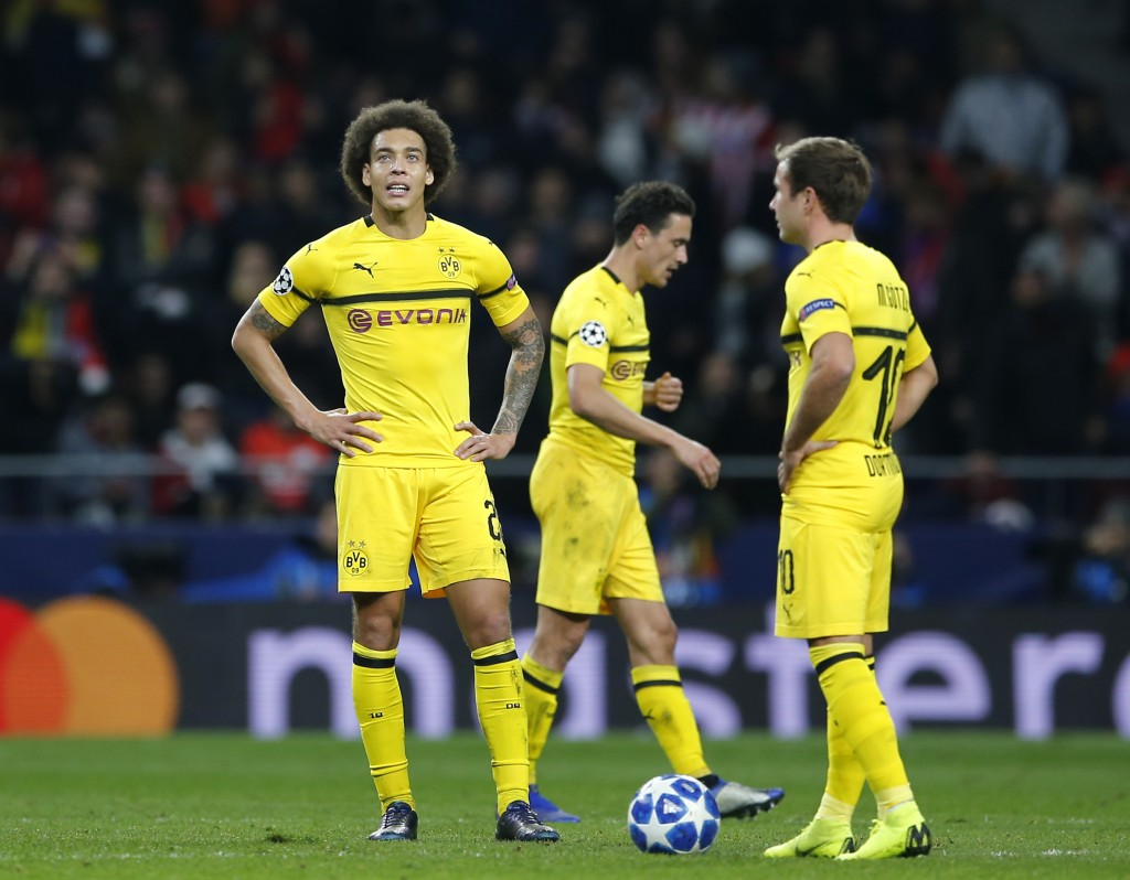 Borussia Dortmund's Axel Witsel, left, and Borussia Dortmund's Mario Gotze react during the Group A Champions League soccer match between Atletico Mad