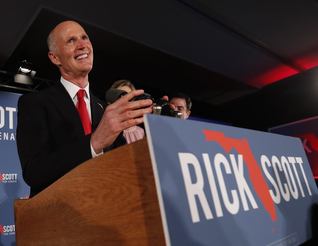 Republican Senate candidate Rick Scott smiles as he speaks to supporters at an election watch party, Wednesday, Nov. 7, 2018, in Naples, Fla. (AP Phot...