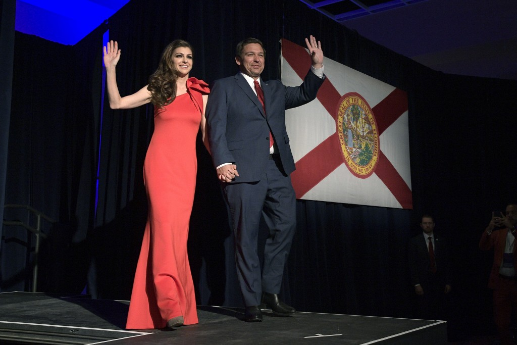 Florida Gov.-elect Ron DeSantis, right, and his wife Casey wave to supporters as they walk onto the stage after he was declared the winner of the elec...
