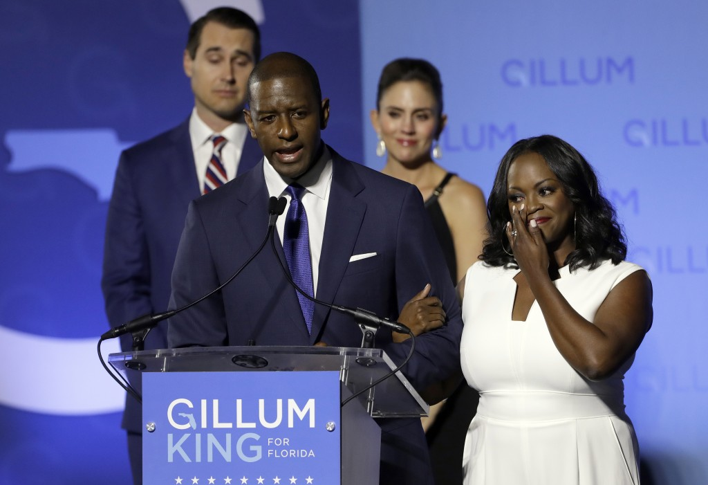 Florida Democratic gubernatorial candidate Andrew Gillum gives his concession speech as he is joined on stage by his wife R. Jai Gillum, right, and ru