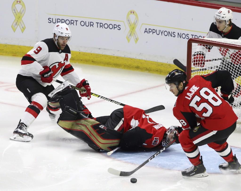 ce293099f32 Ottawa Senators goaltender Craig Anderson (41) takes a tumble as teammate  Maxime Lajoie (