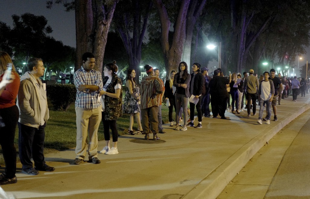 A long line of people wait in the dark on Tuesday to vote at the Los Angeles County Registrar Recorders office in Norwalk, Calif., on Tuesday, Nov. 6,