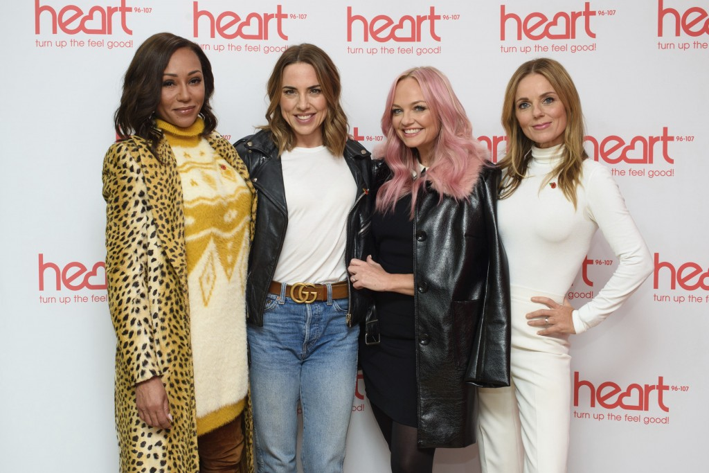 FILE - In this Wednesday, Nov. 7, 2018 file photo, Spice Girls from left, Melanie Brown, Melanie Chisholm, Emma Bunton and Geri Horner  pose for a pho