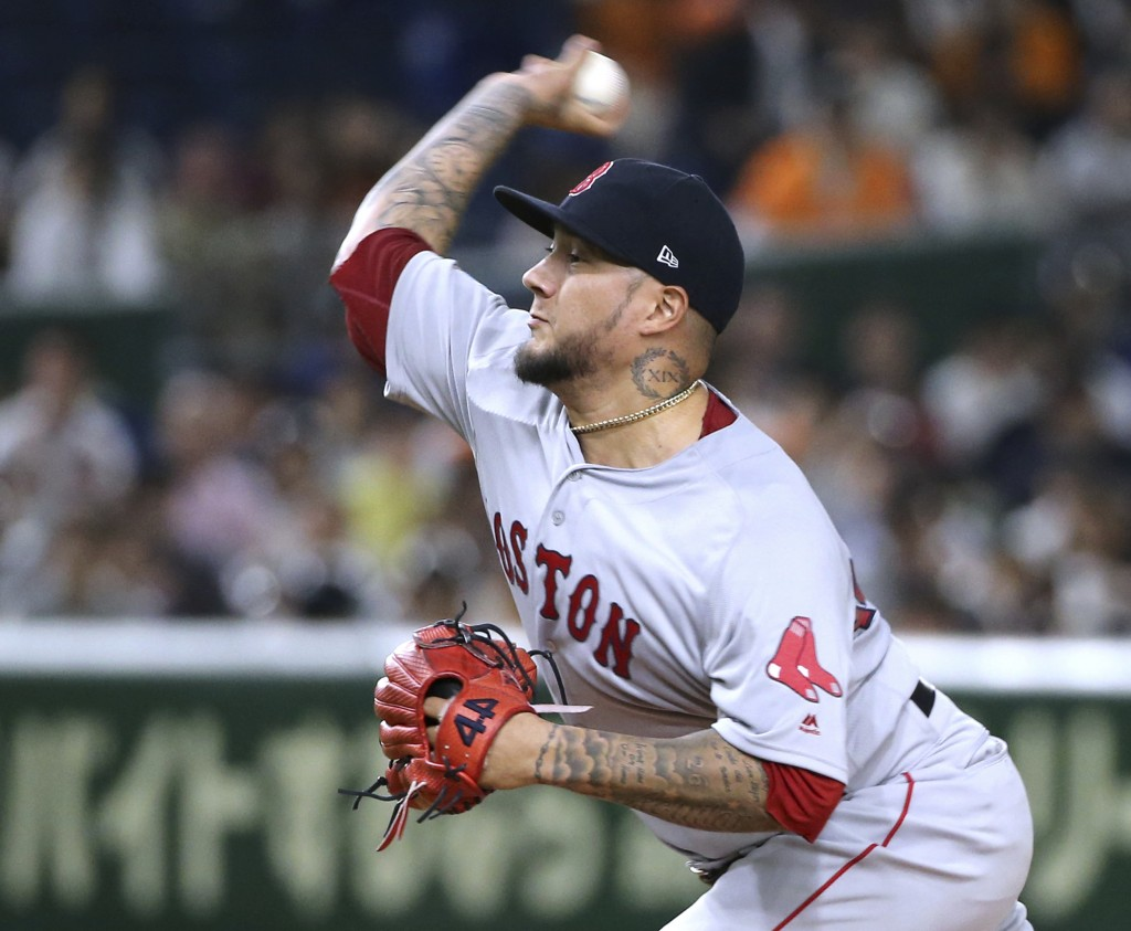 MLB All-Star starting pitcher Hector Velazquez of the Boston Red Sox delivers a pitch against the Yomiuri Giants in the first inning of their exhibiti...