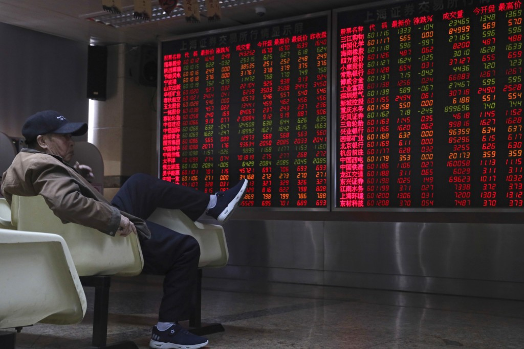 A Chinese man monitors stock prices at a brokerage in Beijing, China, Thursday, Nov. 8, 2018. Asian markets rose on Thursday after the U.S. midterm el
