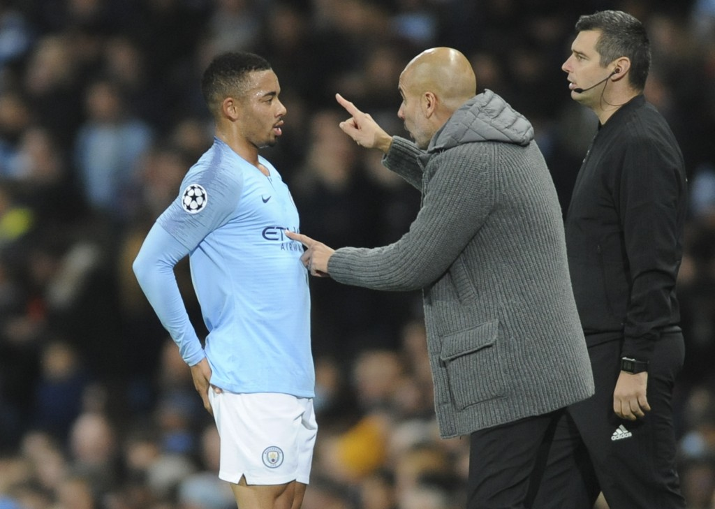 Manchester City coach Pep Guardiola gives instructions to Manchester City forward Gabriel Jesus during the Champions League Group F soccer match betwe