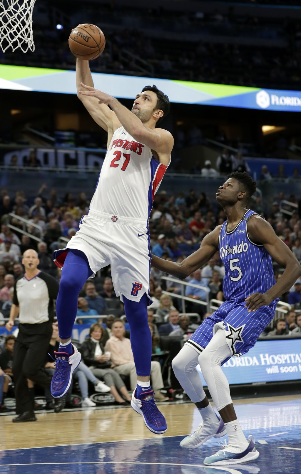 Detroit Pistons' Zaza Pachulia (27) goes past Orlando Magic's Mohamed Bamba (5) for a shot during the first half of an NBA basketball game, Wednesday,...