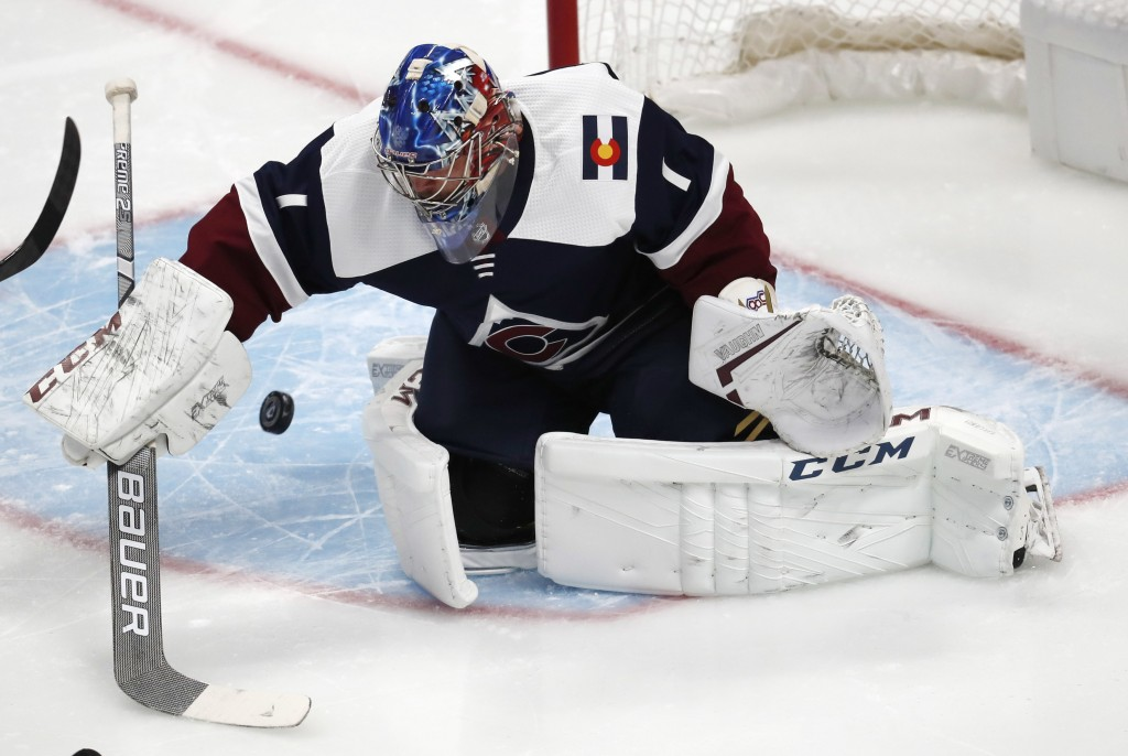 Colorado Avalanche goaltender Semyon Varlamov stops a shot by the Nashville Predators in the first period of an NHL hockey game Wednesday, Nov. 7, 201