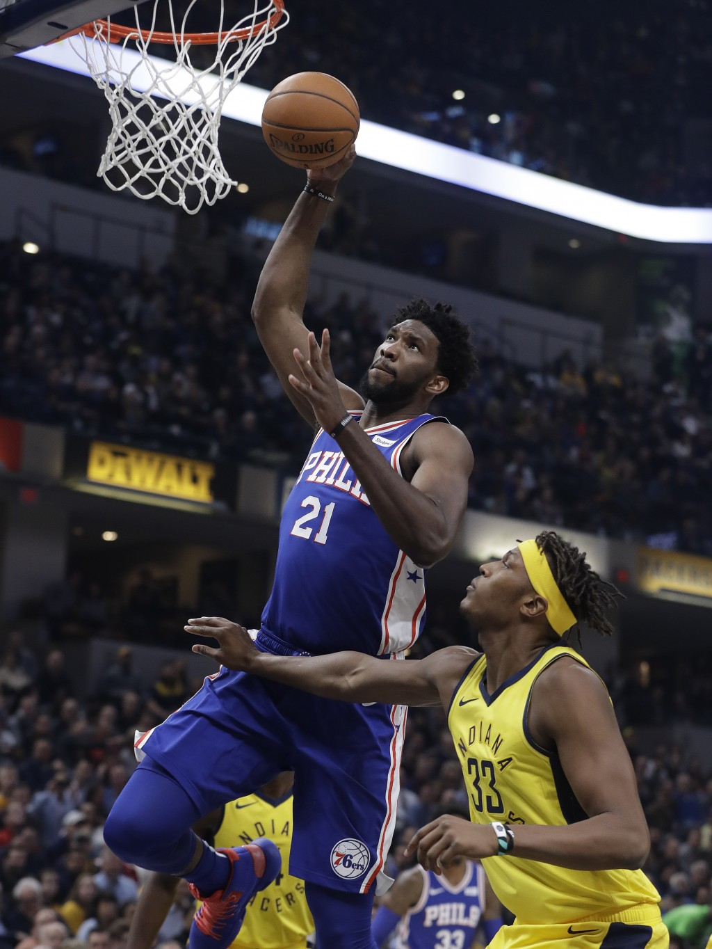 Philadelphia 76ers' Joel Embiid (21) dunks against Indiana Pacers' Myles Turner during the first half of an NBA basketball game, Wednesday, Nov. 7, 20