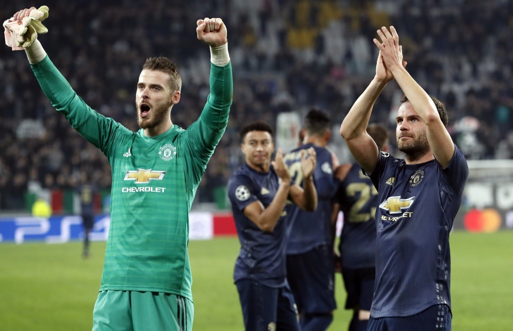 Manchester United's goalkeeper David de Gea, left, and Juan Mata celebrate at the end of the Champions League group H soccer match between Juventus an