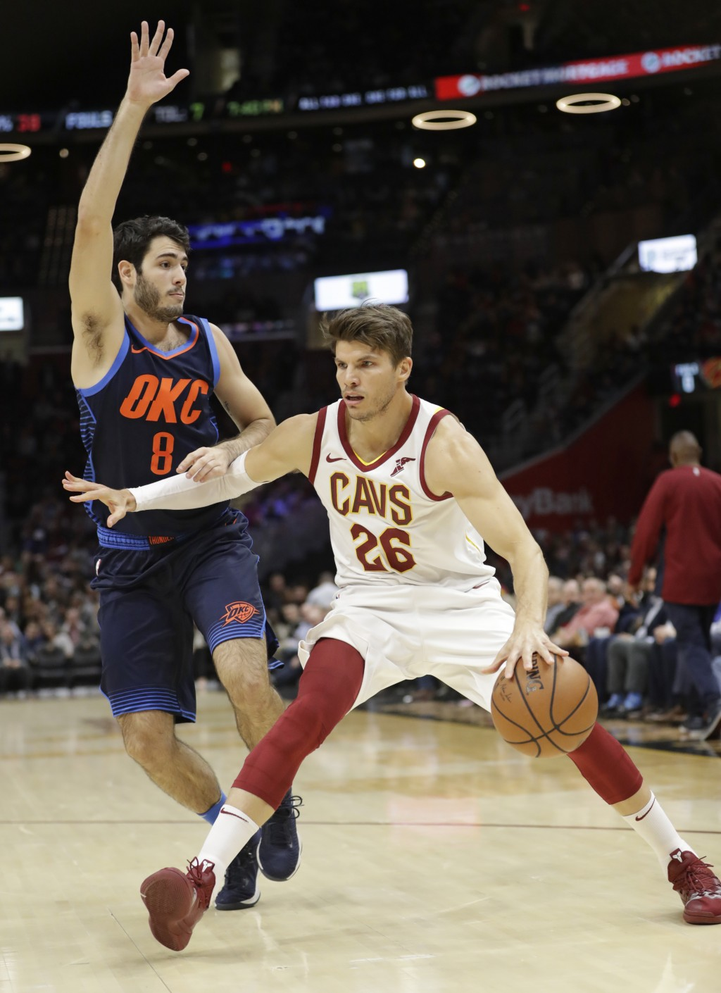 Cleveland Cavaliers' Kyle Korver (26) drives past Oklahoma City Thunder's Alex Abrines (8), of Spain, during the first half of an NBA basketball game