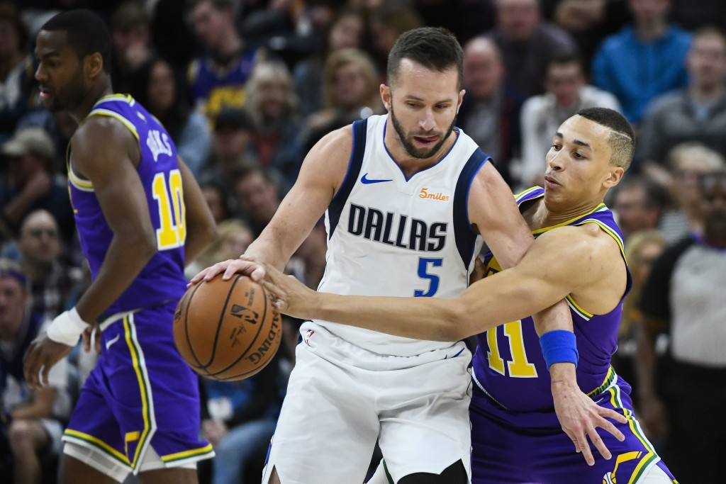Utah Jazz guard Dante Exum (11) guards Dallas Mavericks guard J.J. Barea (5) during the first half of an NBA basketball game Wednesday, Nov. 7, 2018,