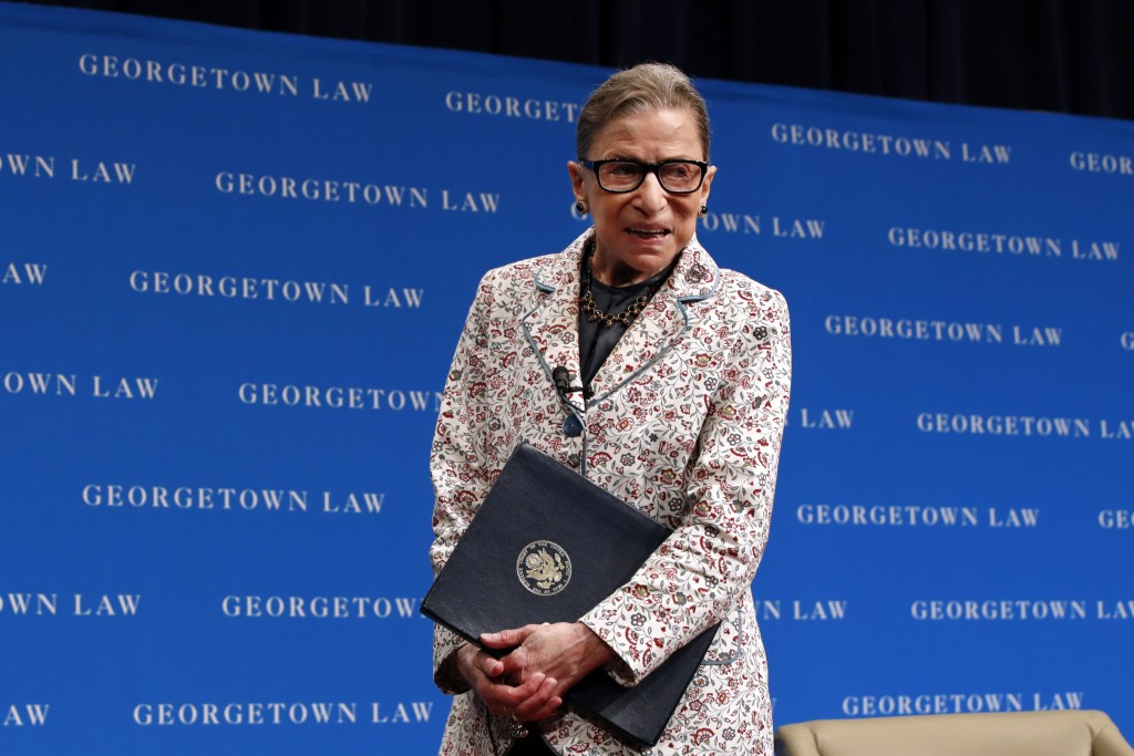 FILE - In this Sept. 26, 2018, file photo, Supreme Court Justice Ruth Bader Ginsburg leaves the stage after speaking to first-year students at Georget
