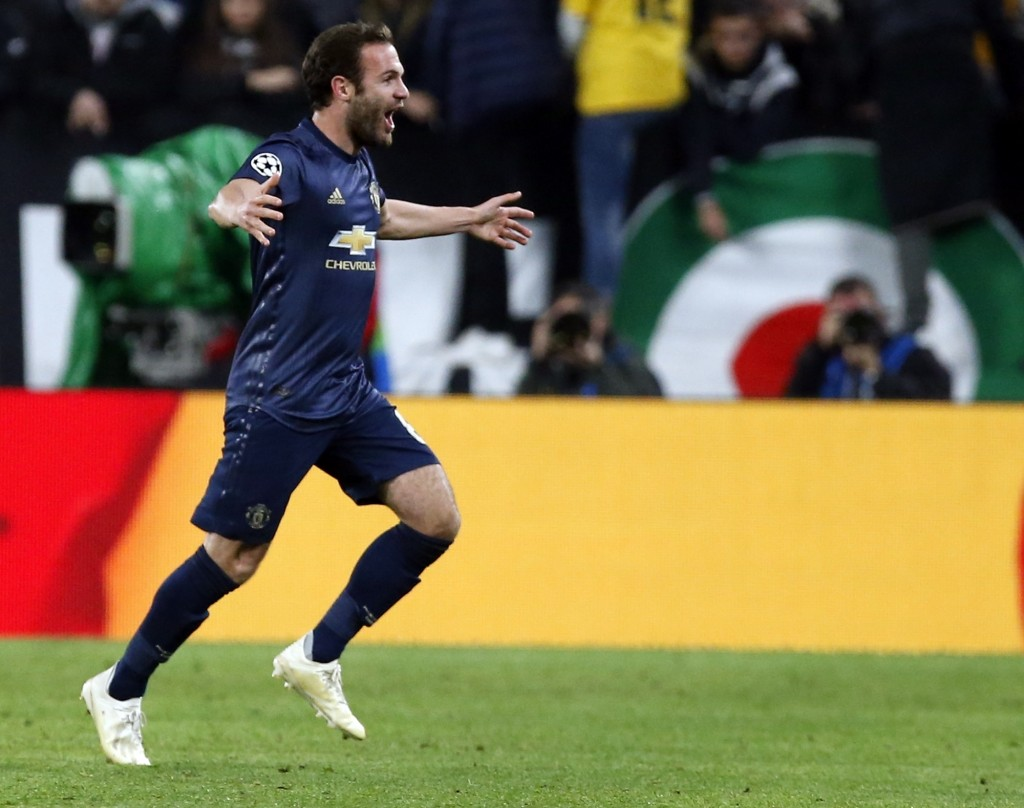 ManU midfielder Juan Mata celebrates after scoring his side's opening goal during the Champions League group H soccer match between Juventus and Manch...