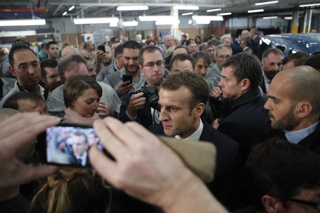 French President Emmanuel Macron speaks to workers at the French carmaker Renault factory of Maubeuge, northern France, Thursday, Nov.8, 2018. (AP Pho...