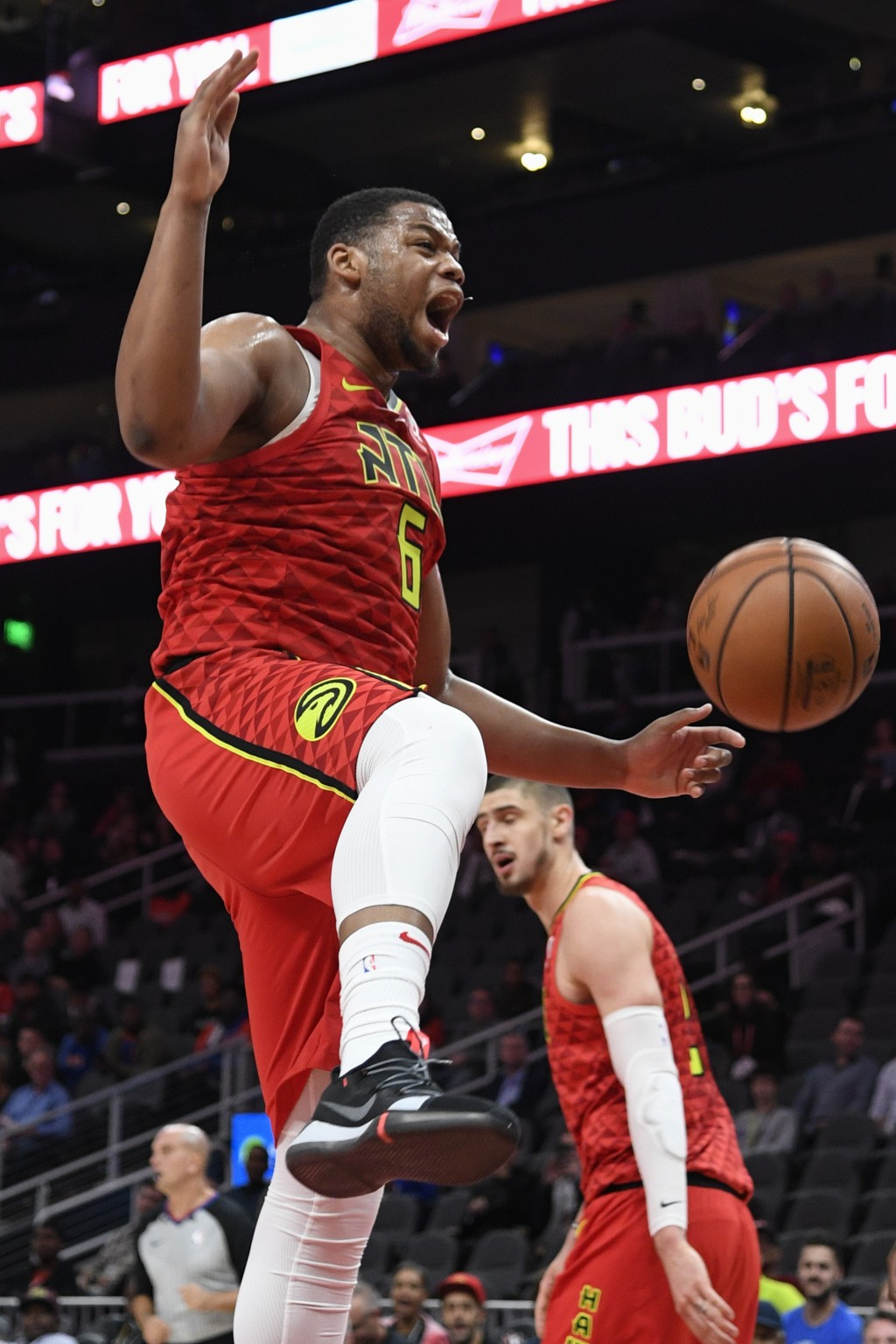 Atlanta Hawks forward Omari Spellman reacts after dunking against the New York Knicks during the first half of an NBA basketball game Wednesday, Nov.