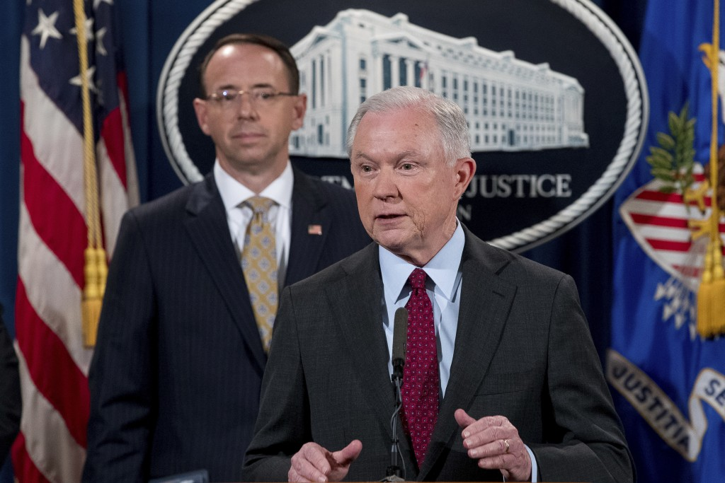 FILE - In this  July 20, 2017 file photo, Attorney General Jeff Sessions accompanied by Deputy Attorney General Rod Rosenstein, speaks at a news confe