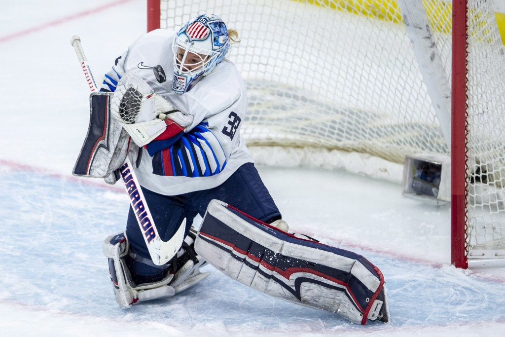 U.S. goaltender Alex Rigsby stops a shot from Canada during the first period of a Four Nations Cup preliminary game in Saskatoon, Saskatchewan, Wednes