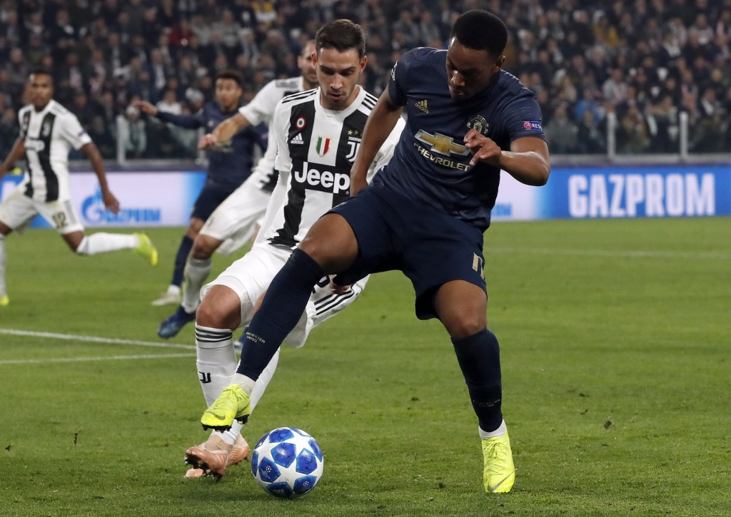 ManU forward Anthony Martial, right, and Juventus defender Mattia De Sciglio vie for the ball during the Champions League group H soccer match between...