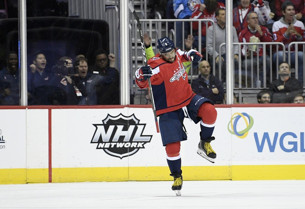 Washington Capitals left wing Alex Ovechkin (8), of Russia, celebrates his goal during the second period of an NHL hockey game against the Pittsburgh ...