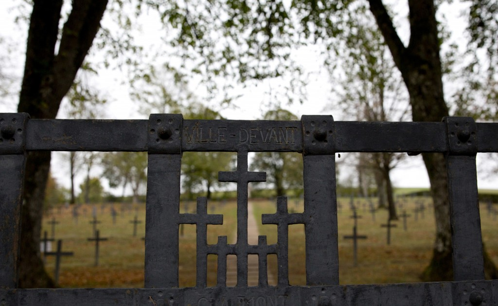 In this photo taken on Monday, Oct. 29, 2018, an iron gate leads to a World War I German cemetery in Ville-devant-Chaumont, France. The cemetery conta