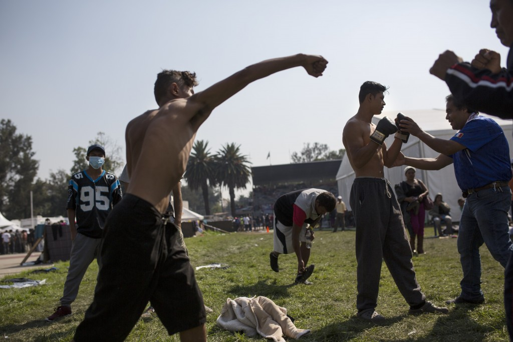 A Central American migrant shadowboxes during a rest day at the Jesus Martinez stadium in Mexico City, Wednesday, Nov. 7, 2018. Central American migra