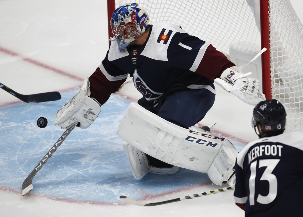 Colorado Avalanche goaltender Semyon Varlamov makes a stick save of a shot against the Nashville Predators in the first period of an NHL hockey game W