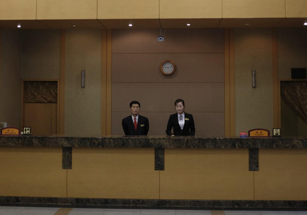 In this Oct. 23, 2018, photo, members of the staff stand behind the reception desk at the Kumgangsan Hotel at the Mount Kumgang resort area in North K