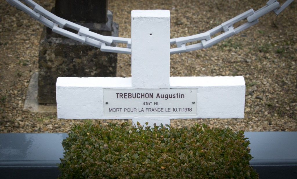 In this photo taken on Tuesday, Oct. 30, 2018, the grave marker of French WWI soldier Augustin Trebuchon in Vrigne-Meuse, France. His tiny plot is alm...