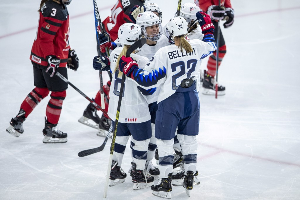 U.S. forward Hannah Brandt and teammates celebrate a goal against Canada during the first period of a Four Nations Cup hockey preliminary game in Sask