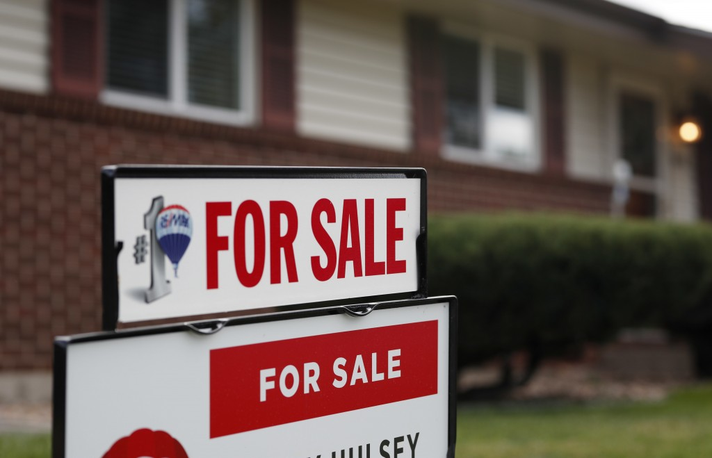 FILE- In this Oct 2, 2018, file photo a for sale sign stands outside a home on the market in the north Denver suburb of Thornton, Colo. On Thursday, N...