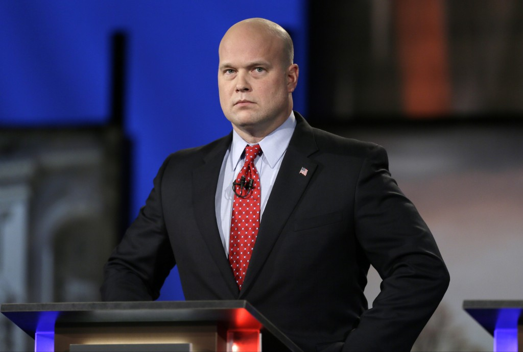 FILE - In this April 24, 2014, file photo, then-Iowa Republican senatorial candidate and former U.S. Attorney Matt Whitaker watches before a live tele