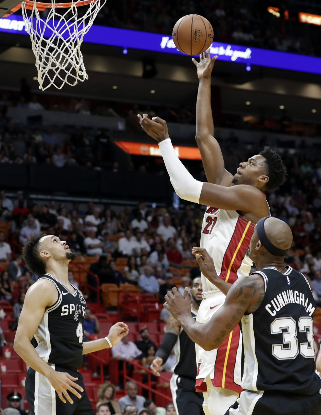 Miami Heat center Hassan Whiteside (21) shoots over San Antonio Spurs guard Derrick White (4) and forward Dante Cunningham (33) during the first half ...