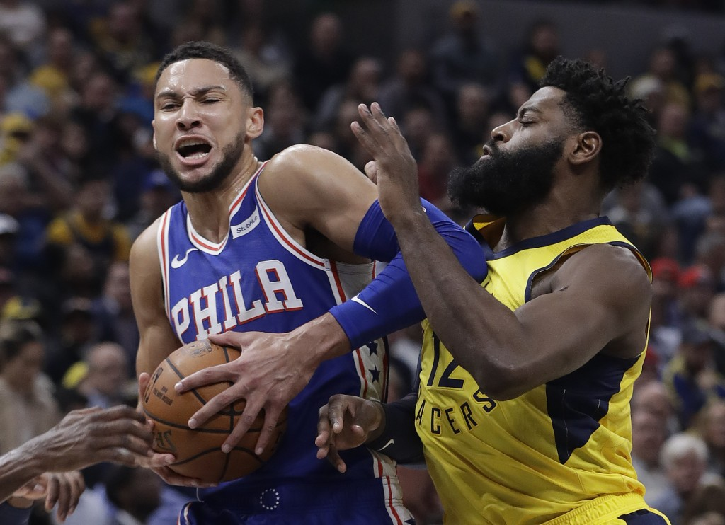Philadelphia 76ers' Ben Simmons goes to the basket against Indiana Pacers' Tyreke Evans during the first half of an NBA basketball game, Wednesday, No