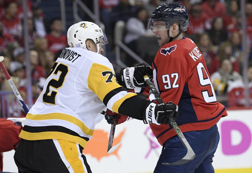 Washington Capitals center Evgeny Kuznetsov (92), of Russia, scuffles with Pittsburgh Penguins right wing Patric Hornqvist (72), Sweden, during the se...