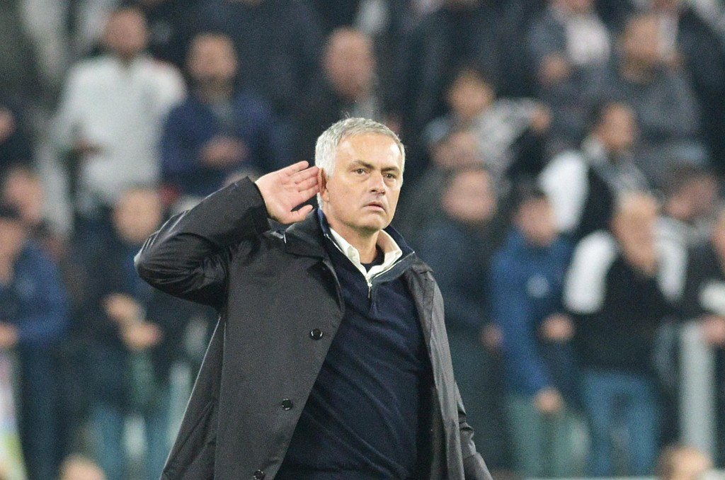 Manchester United coach Jose Mourinho reacts towards Juventus' fans at the end of of the Champions League Group H soccer match between Juventus and Ma