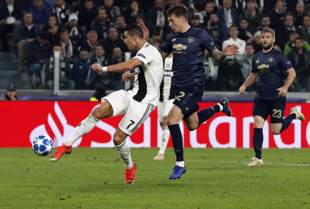 Juventus forward Cristiano Ronaldo scores his side's opening goal during the Champions League group H soccer match between Juventus and Manchester Uni