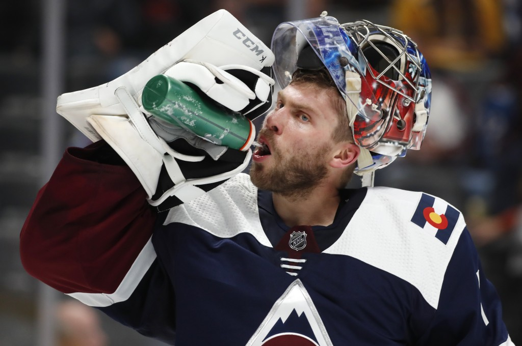Colorado Avalanche goaltender Semyon Varlamov takes a drink during a break in the second period of the team's NHL hockey game against the Nashville Pr