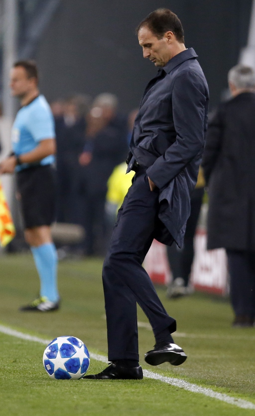 Juventus coach Massimiliano Allegri kicks the ball into the pitch during the Champions League group H soccer match between Juventus and Manchester Uni