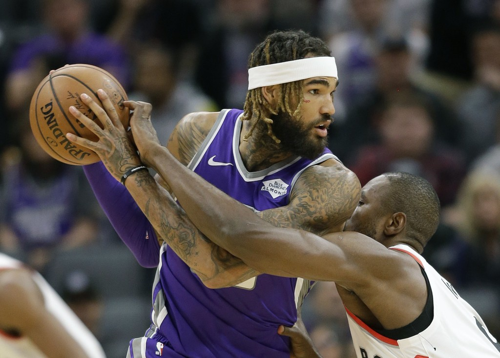 Sacramento Kings center Willie Cauley-Stein, left, tries to keep the ball out of the reach of Toronto Raptors forward Serge Ibaka, right, during the f