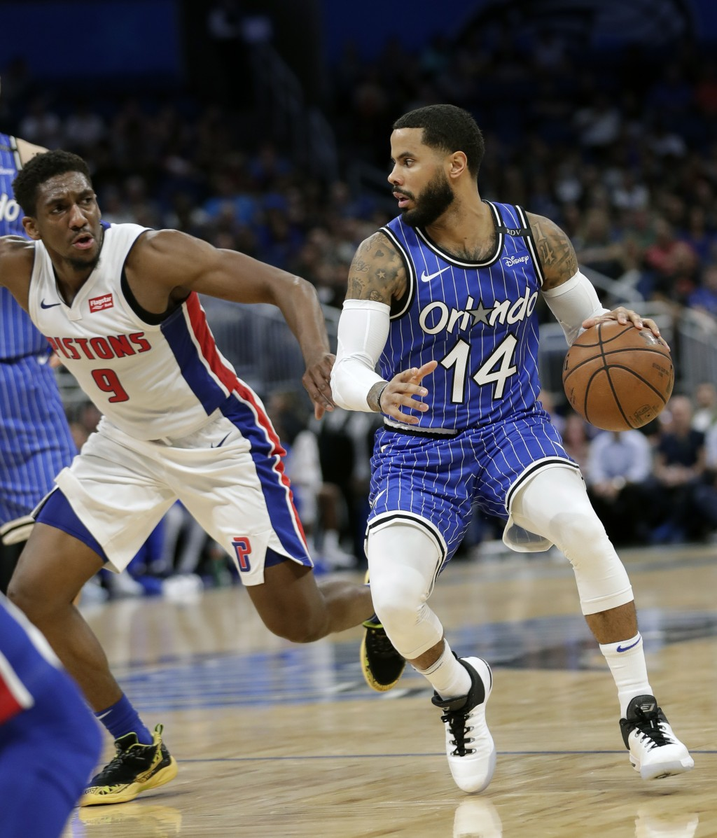 Orlando Magic's D.J. Augustin (14) looks for a way past Detroit Pistons' Langston Galloway (9) during the second half of an NBA basketball game, Wedne...